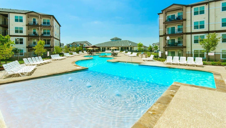 Large sun deck in the pool at Olympus Woodbridge in Sachse, Texas