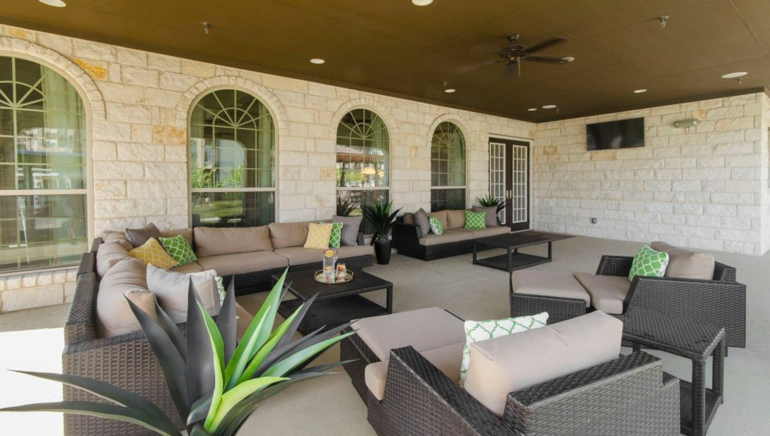 Large covered outdoor lounge at Olympus Woodbridge in Sachse, Texas