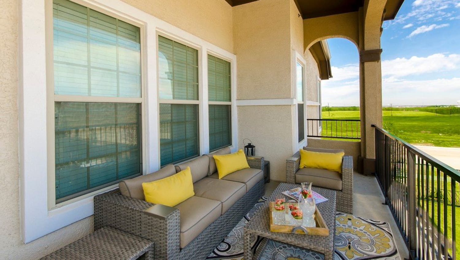Expansive and well-furnished private balcony outside a model townhome at Olympus Woodbridge in Sachse, Texas