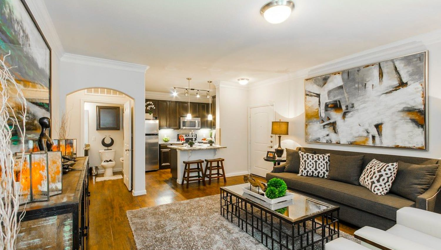 Very well-furnished model apartment's living area at Olympus Woodbridge in Sachse, Texas