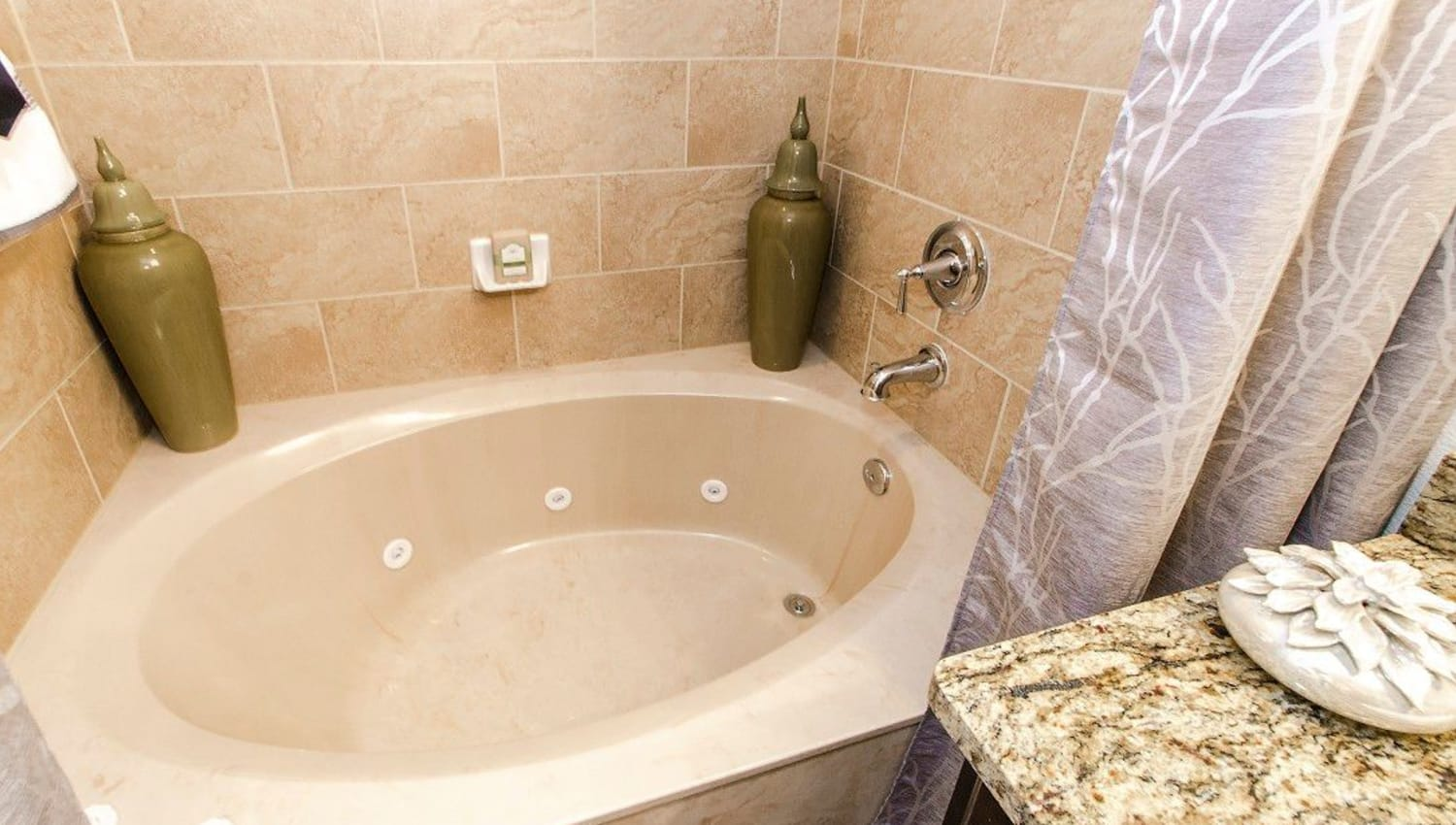 Oval soaking tub in a model home's master bathroom at Olympus Woodbridge in Sachse, Texas