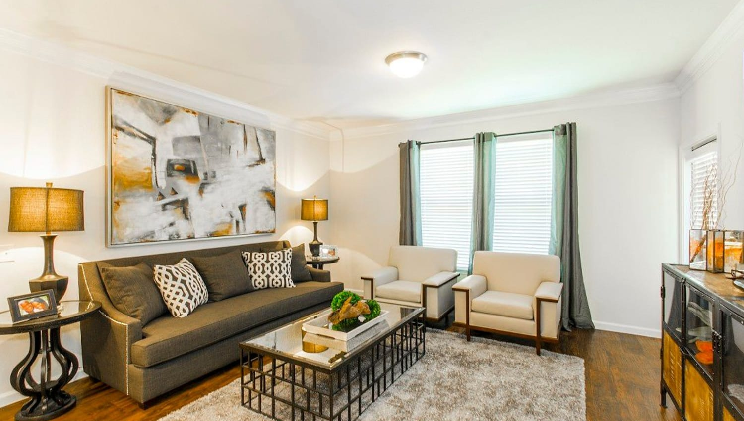 Classic decor in a model home's living area at Olympus Woodbridge in Sachse, Texas