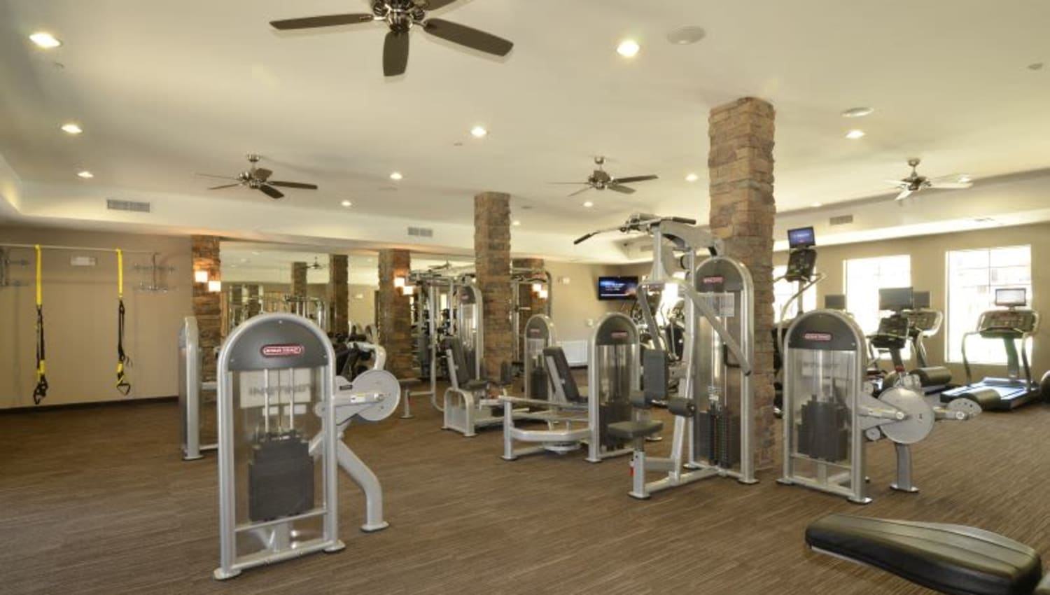 Ample exercise equipment in the fitness center at Redstone at SanTan Village in Gilbert, Arizona
