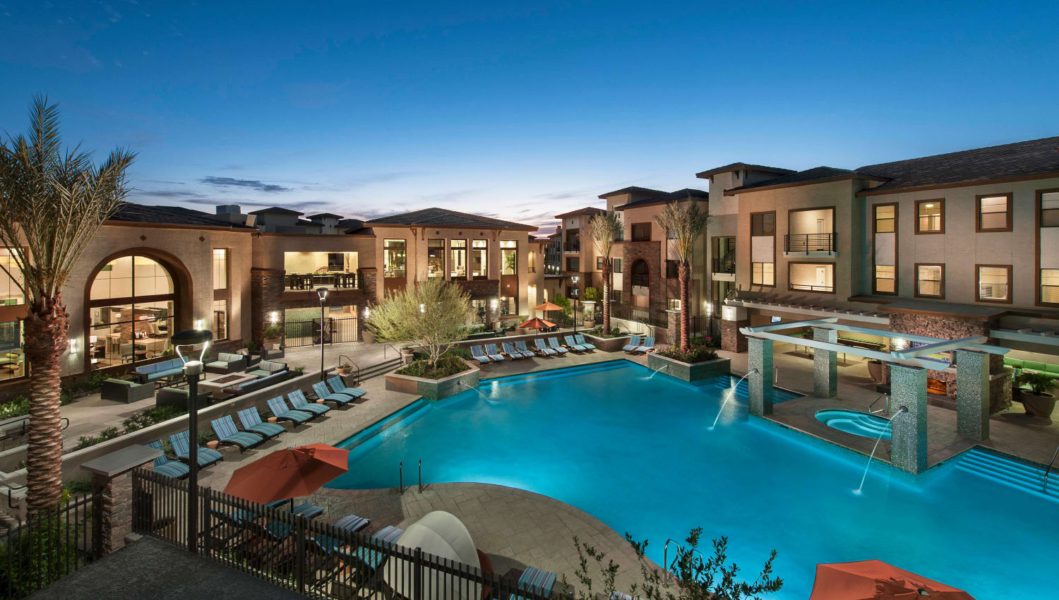 View of the pool area at dusk from an upper-floor home at Redstone at SanTan Village in Gilbert, Arizona