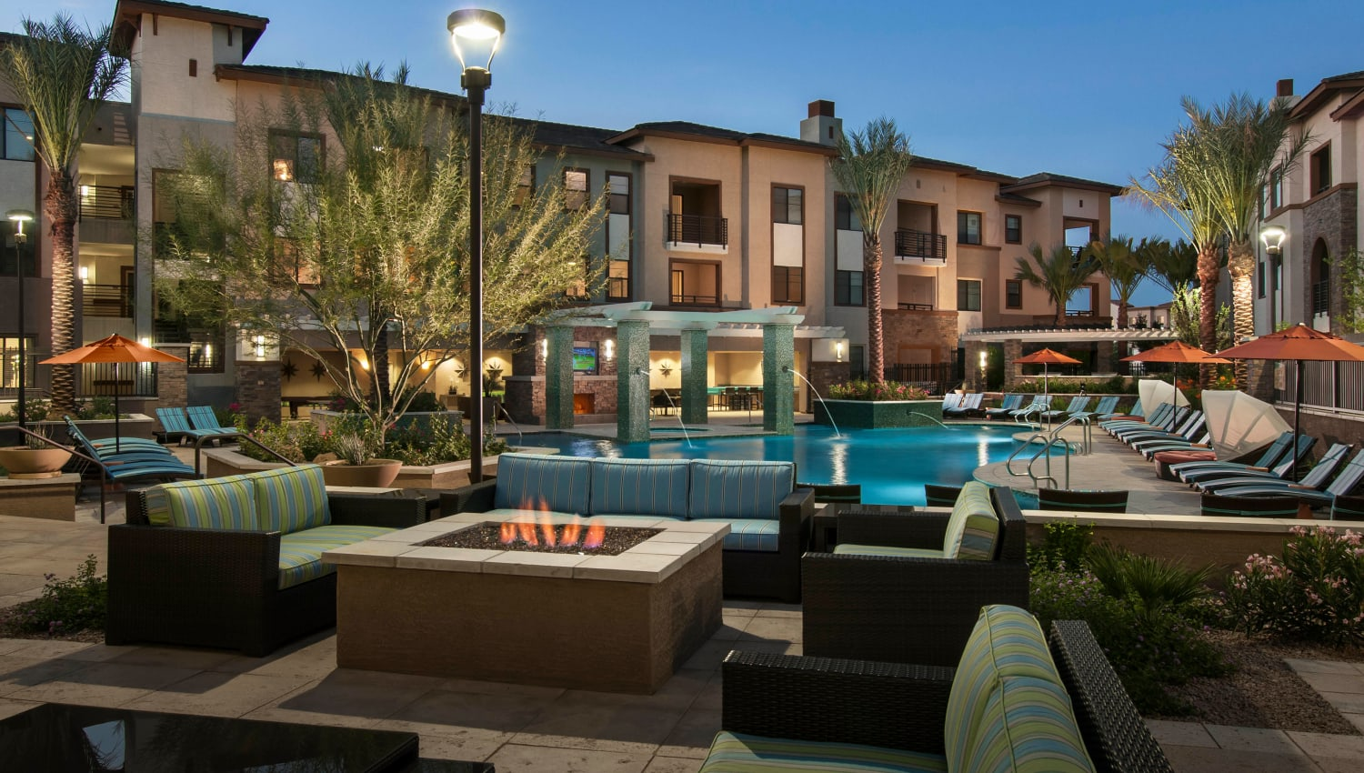 Fire pit lounge area at twilight at Redstone at SanTan Village in Gilbert, Arizona