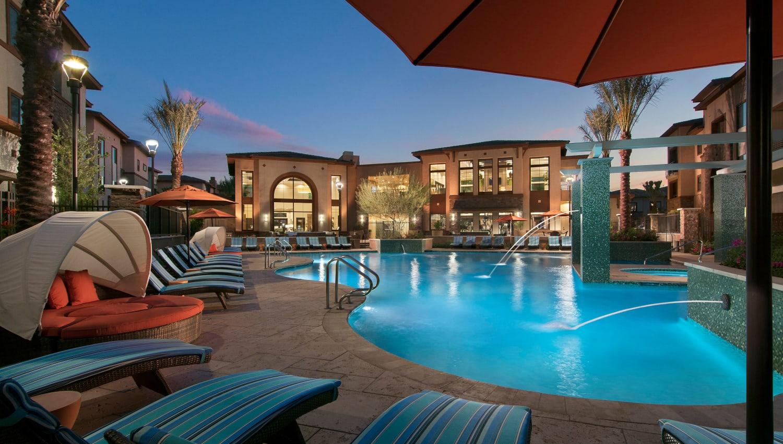 Resort-style swimming pool at dusk at Redstone at SanTan Village in Gilbert, Arizona