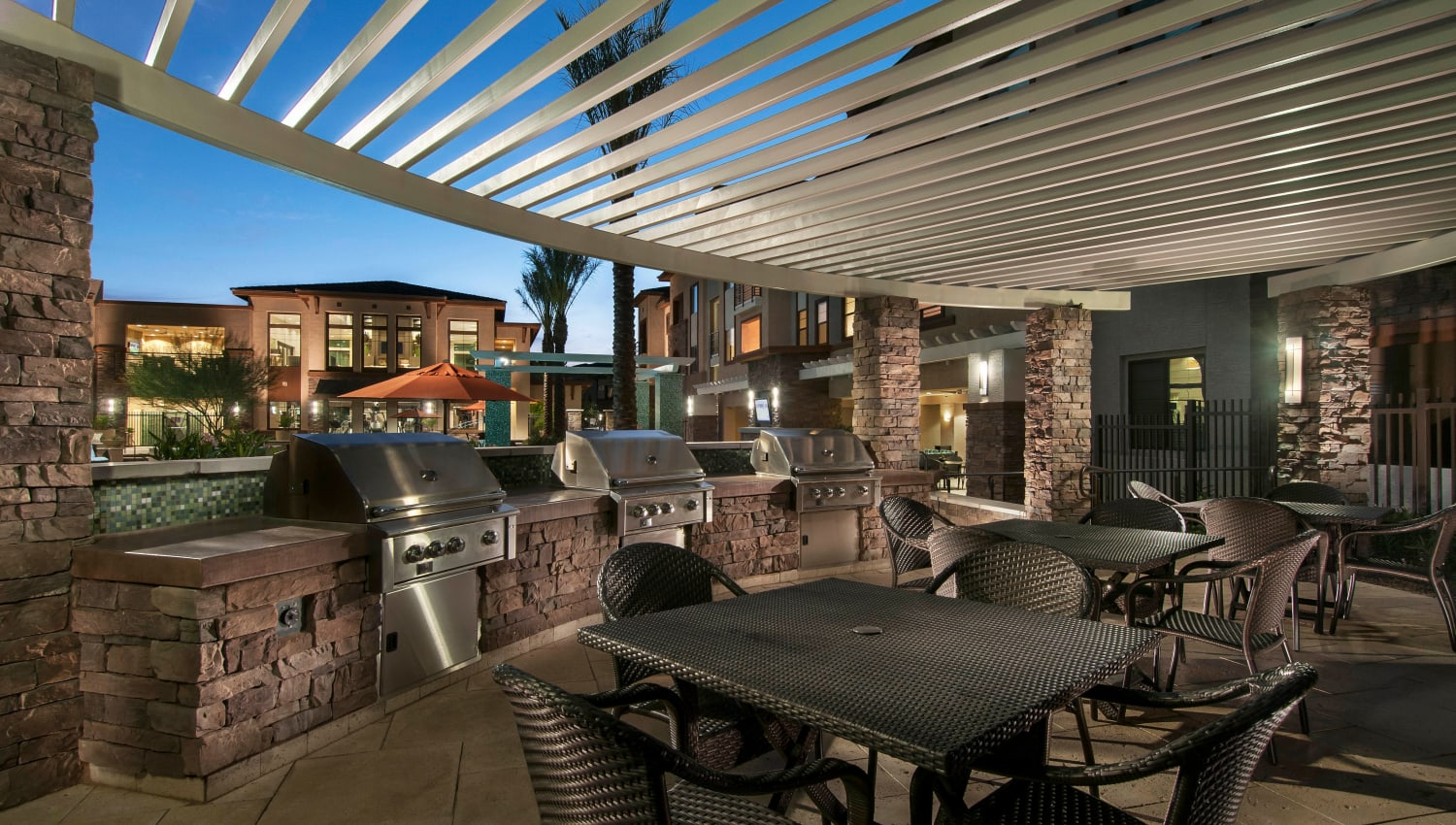 Pergola over the barbecue area at twilight at Redstone at SanTan Village in Gilbert, Arizona