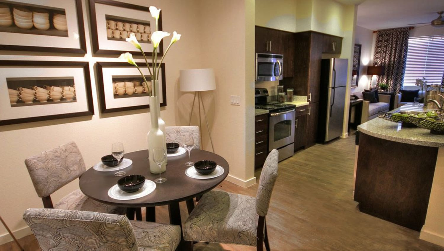 View of the kitchen from the dining area of a model home at Redstone at SanTan Village in Gilbert, Arizona