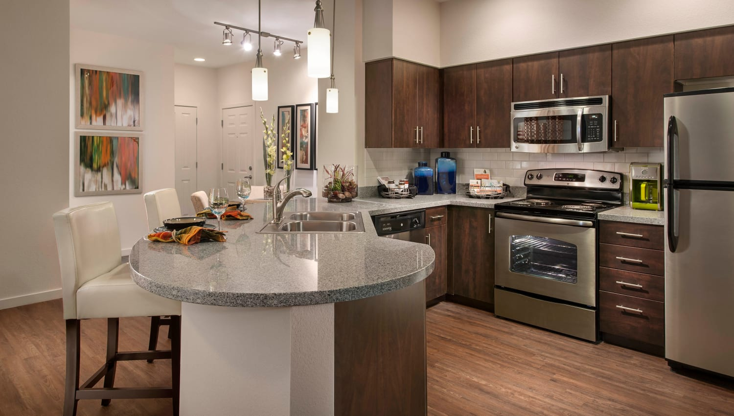 Gourmet kitchen with an island in a model home at Redstone at SanTan Village in Gilbert, Arizona
