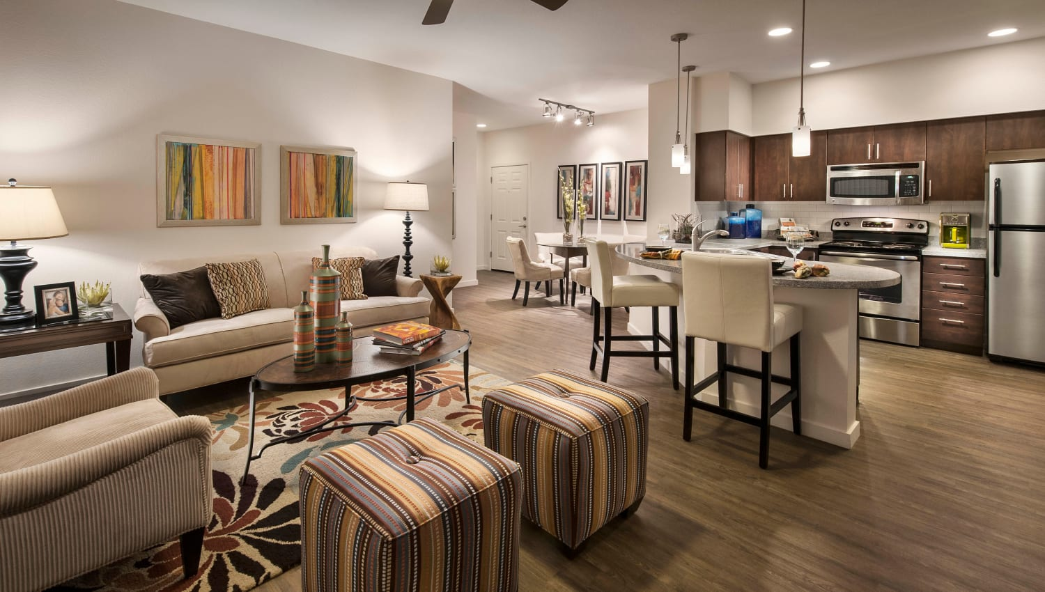 Spacious open-concept model home with hardwood flooring throughout the living areas at Redstone at SanTan Village in Gilbert, Arizona