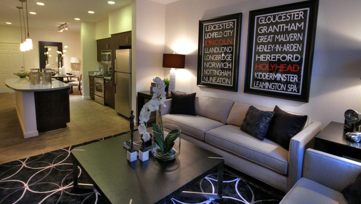 Well-furnished living space in a model home at Redstone at SanTan Village in Gilbert, Arizona
