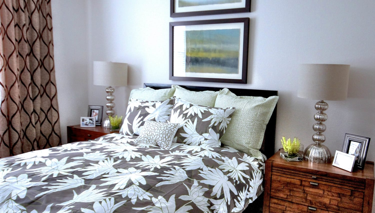 Comfortable furnishings in a model home's bedroom at Redstone at SanTan Village in Gilbert, Arizona