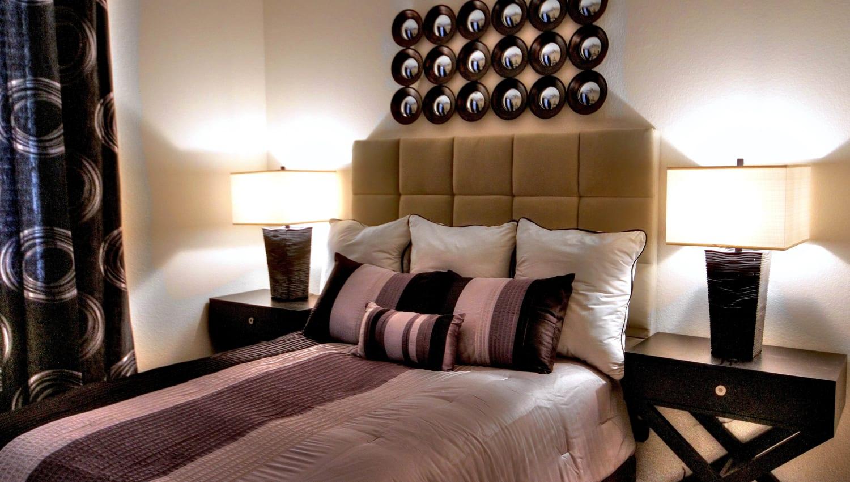 Lavishly furnished bedroom in a model home at Redstone at SanTan Village in Gilbert, Arizona