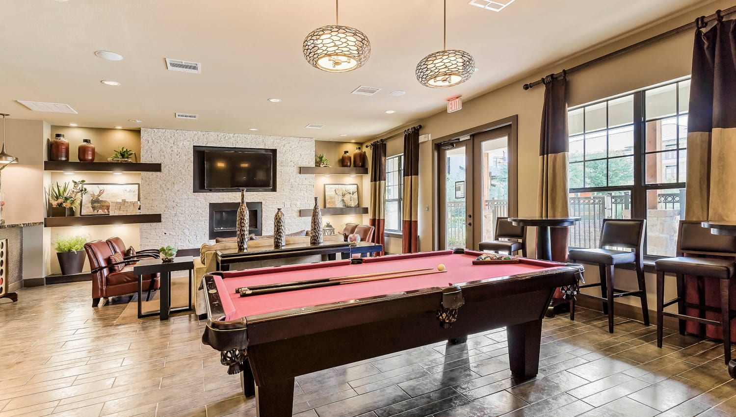 Billiards table and more in the game room at Sedona Ranch in Odessa, Texas