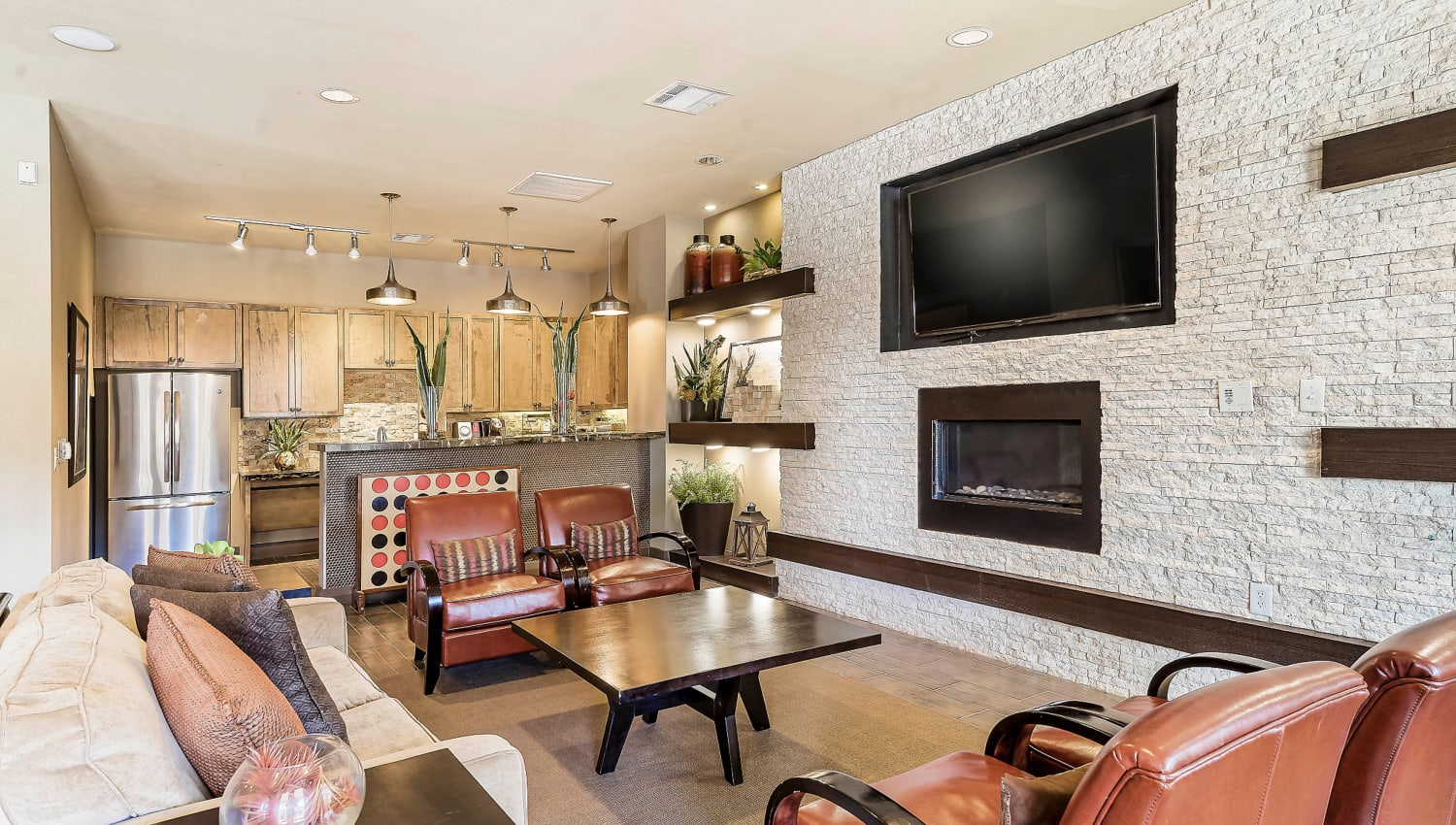 Flatscreen TV above the fireplace at the clubhouse lounge at Sedona Ranch in Odessa, Texas