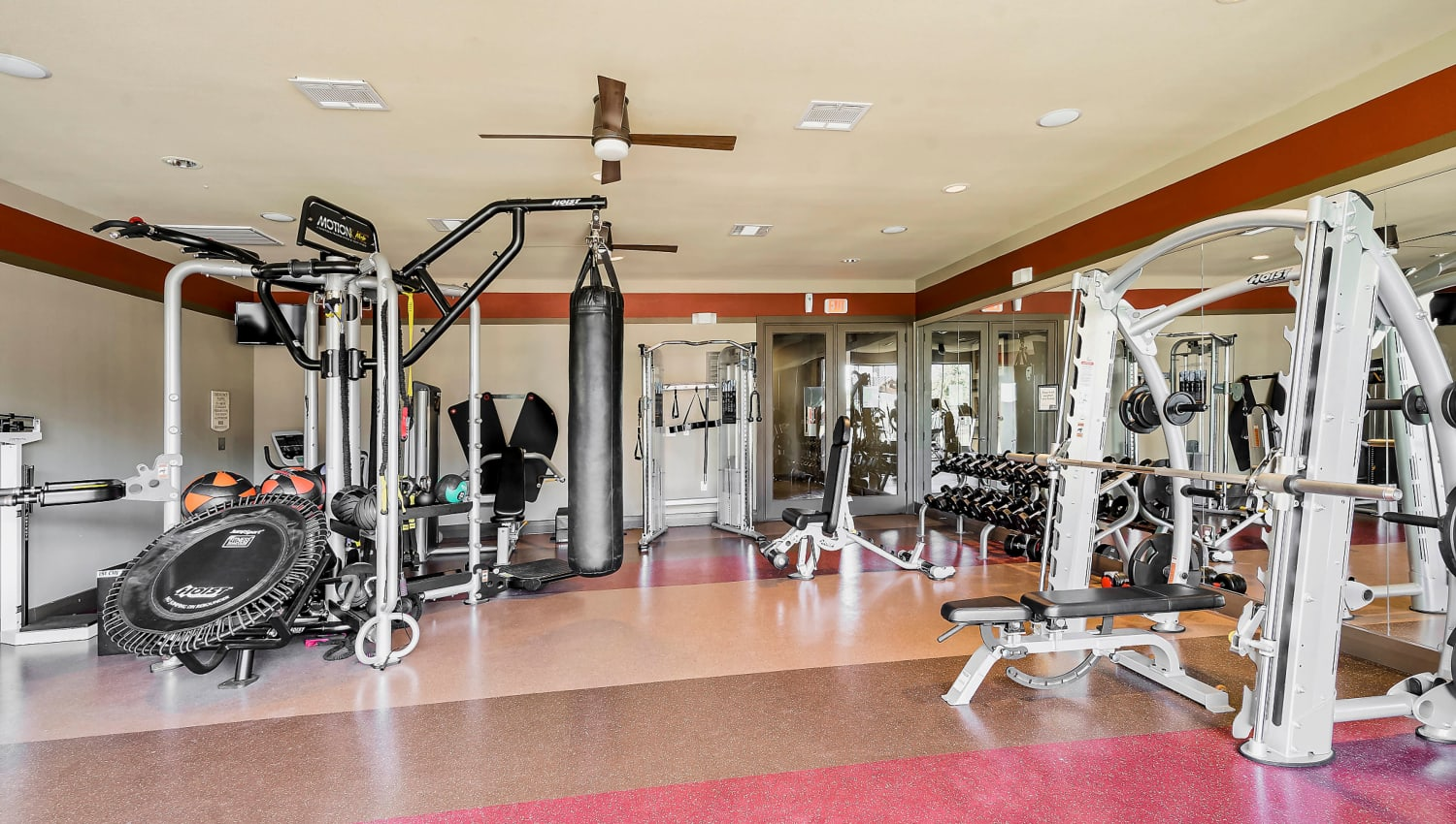 Free weights and exercise machines in the fitness center at Sedona Ranch in Odessa, Texas