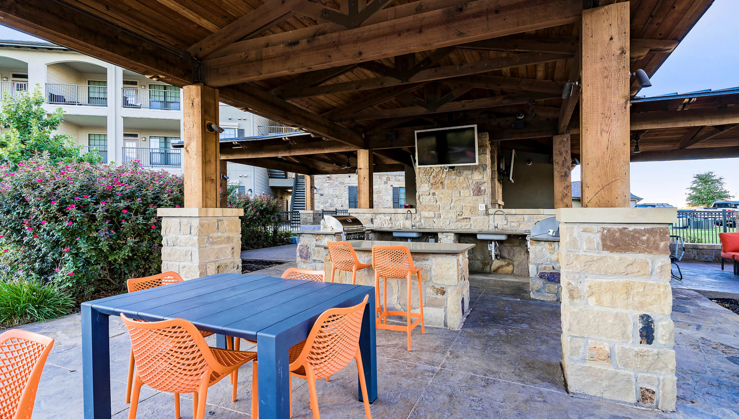 Covered barbecue area with ample seating at Sedona Ranch in Odessa, Texas