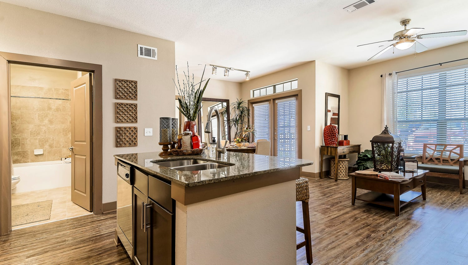 Kitchen with an island and bar seating in a model home at Sedona Ranch in Odessa, Texas