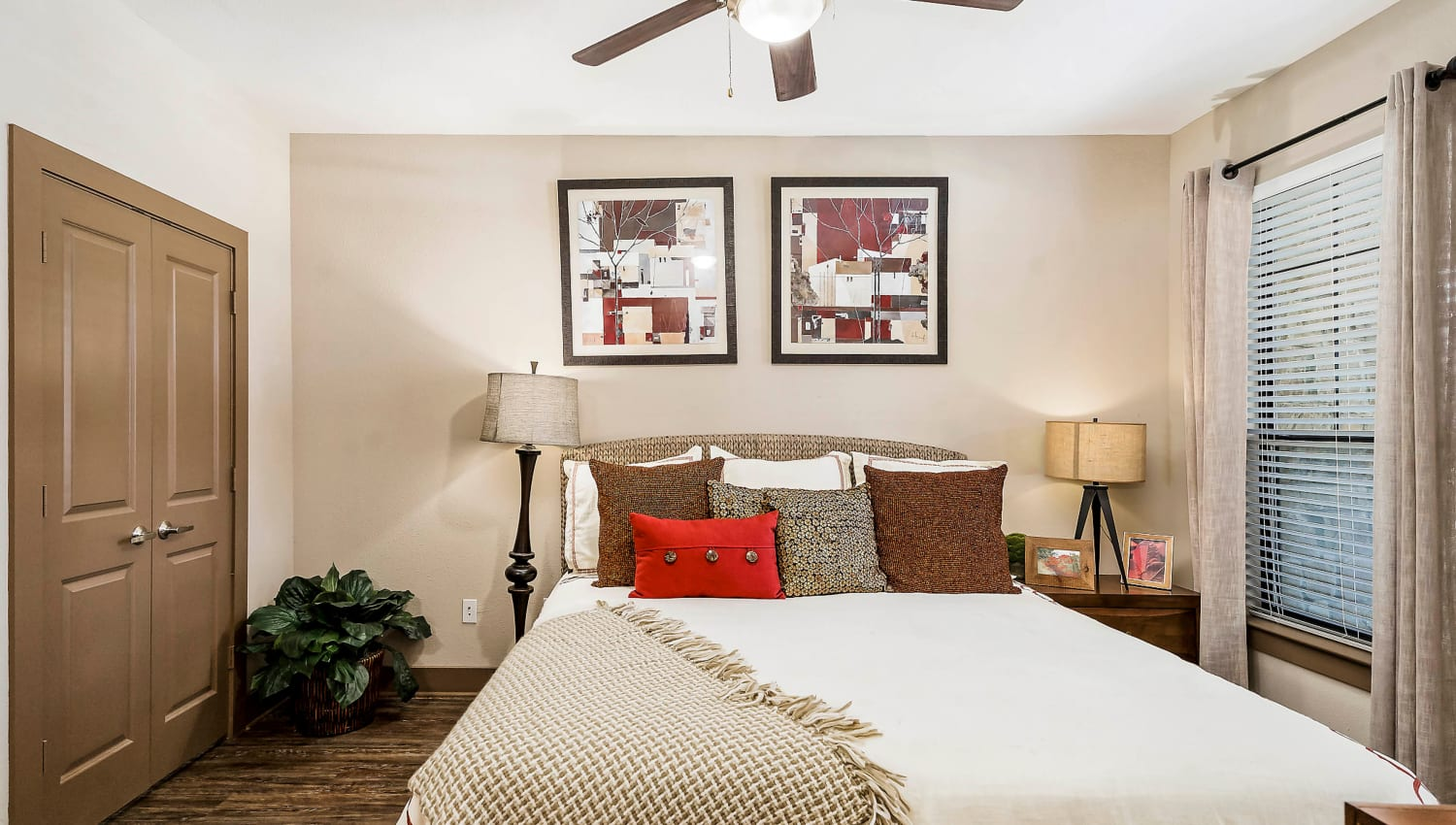 Ceiling fan and modern decor in a model home's master bedroom at Sedona Ranch in Odessa, Texas