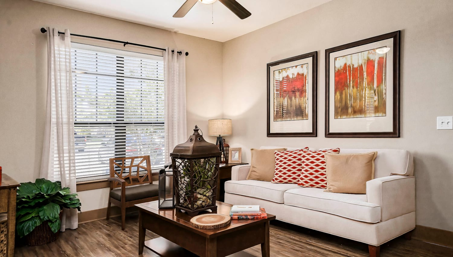 Classic furnishings and a ceiling fan in a model home's living area at Sedona Ranch in Odessa, Texas