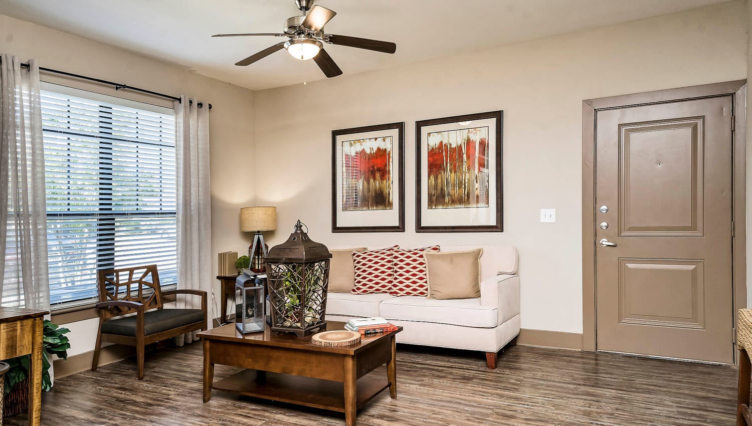 Ceiling fan and hardwood floors in a model home's living area at Sedona Ranch in Odessa, Texas