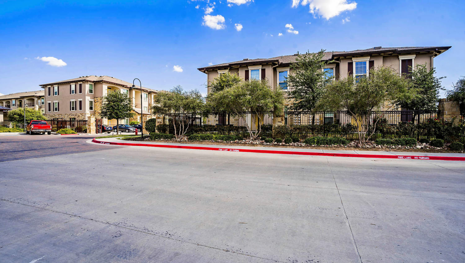 Mature trees and wide driveways throughout the community at Sundance Creek in Midland, Texas