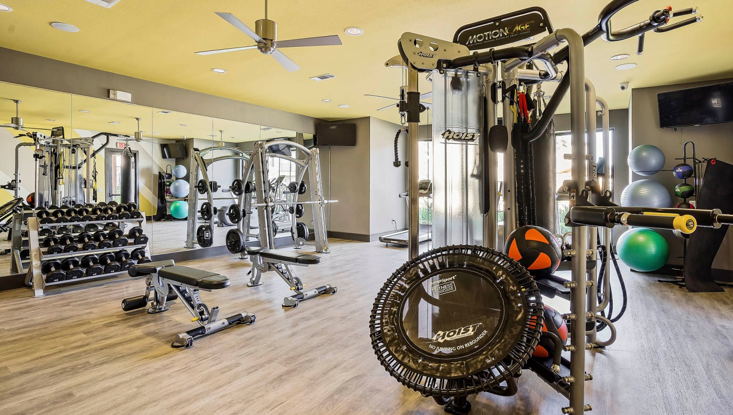 Free weights and exercise machines in the fitness center at Sundance Creek in Midland, Texas
