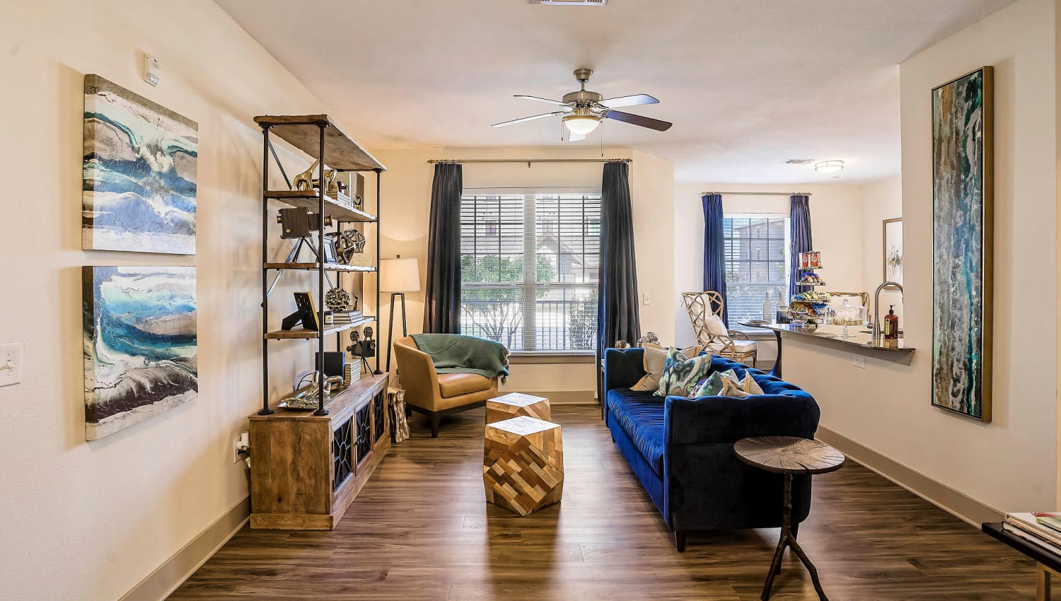 Well-furnished living space with a ceiling fan in a model home at Sundance Creek in Midland, Texas
