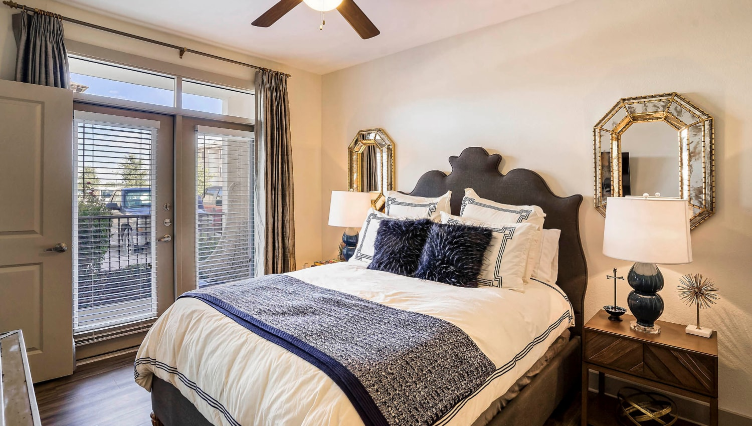 Ceiling fan and hardwood floors in a model home's master bedroom at Sundance Creek in Midland, Texas