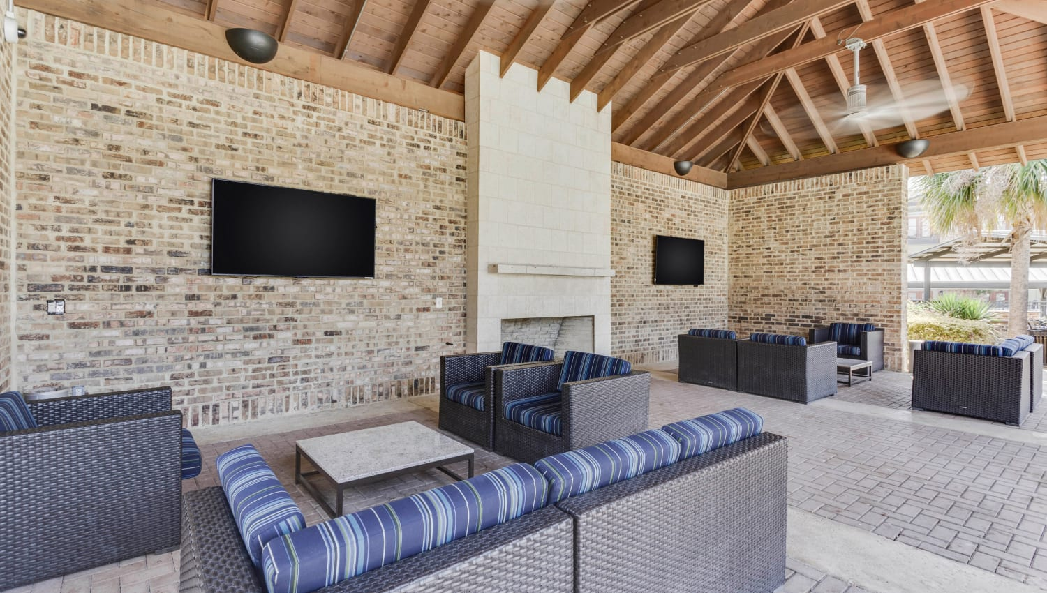 Flatscreen TV at an outdoor covered lounge area at Tacara at Westover Hills in San Antonio, Texas
