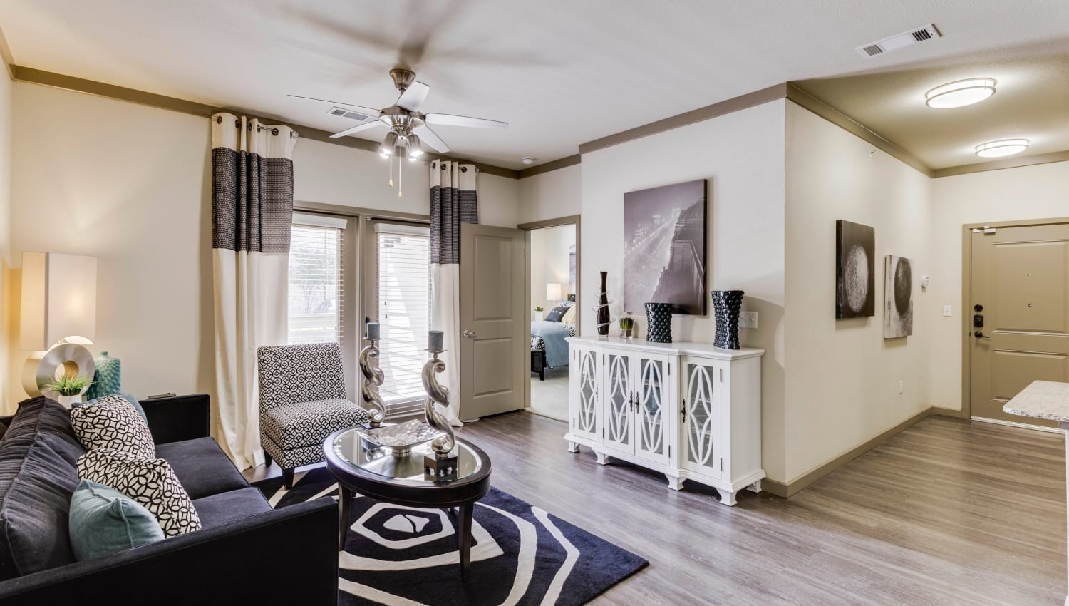 Hardwood floors and a ceiling fan in a model apartment at Tacara at Westover Hills in San Antonio, Texas