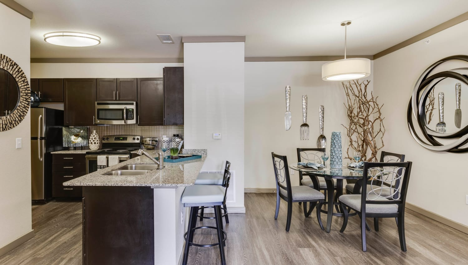 Spacious dining area near the kitchen in a model home at Tacara at Westover Hills in San Antonio, Texas