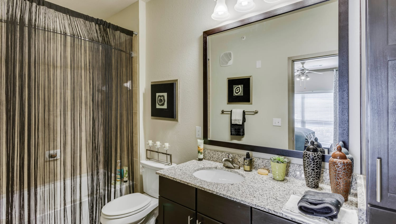 Granite countertop in a model home's bathroom at Tacara at Westover Hills in San Antonio, Texas