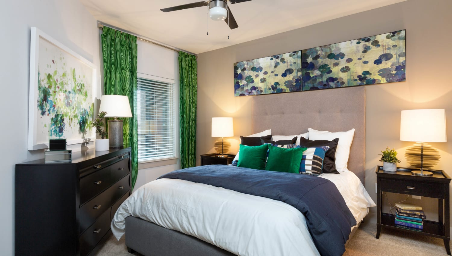 Ceiling fan and plush carpeting in a model home's bedroom at The Davis in Fort Worth, Texas