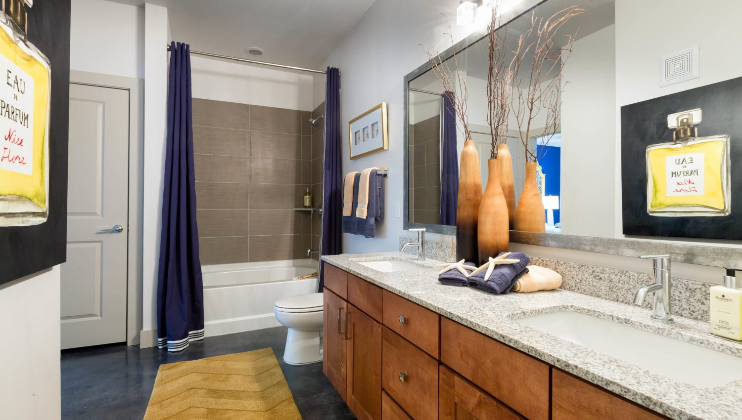 Spacious master bathroom with a custom tiled shower in a model home at The Davis in Fort Worth, Texas