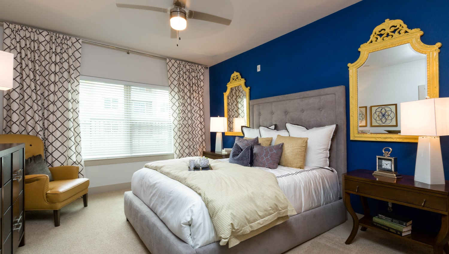 Plush carpeting and an accent wall in a model home's master bedroom at The Davis in Fort Worth, Texas
