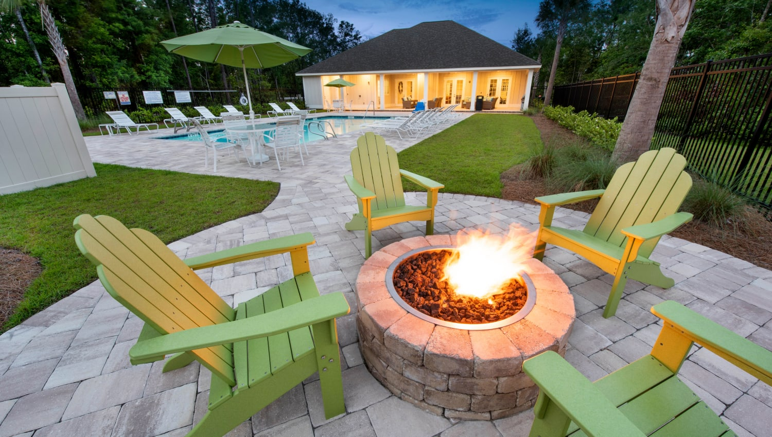 Dusk at the fire pit area near the pool at The Enclave in Brunswick, Georgia