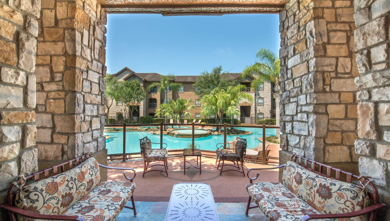 Terrific view of the pool from one of the covered lounge areas at The Ranch at Shadow Lake in Houston, Texas