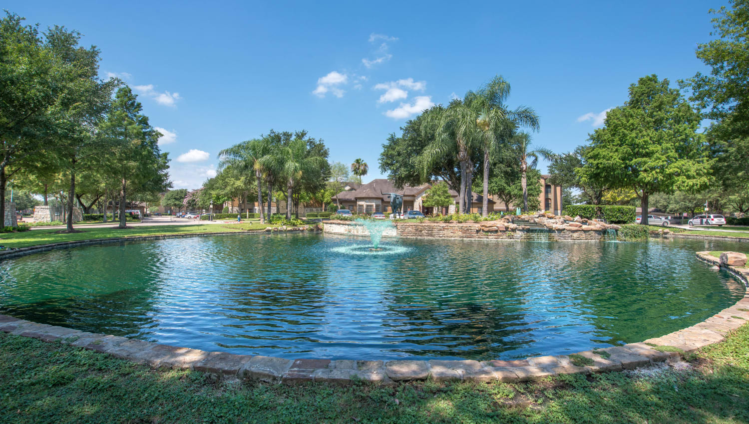 Onsite pond surrounded by mature trees at The Ranch at Shadow Lake in Houston, Texas
