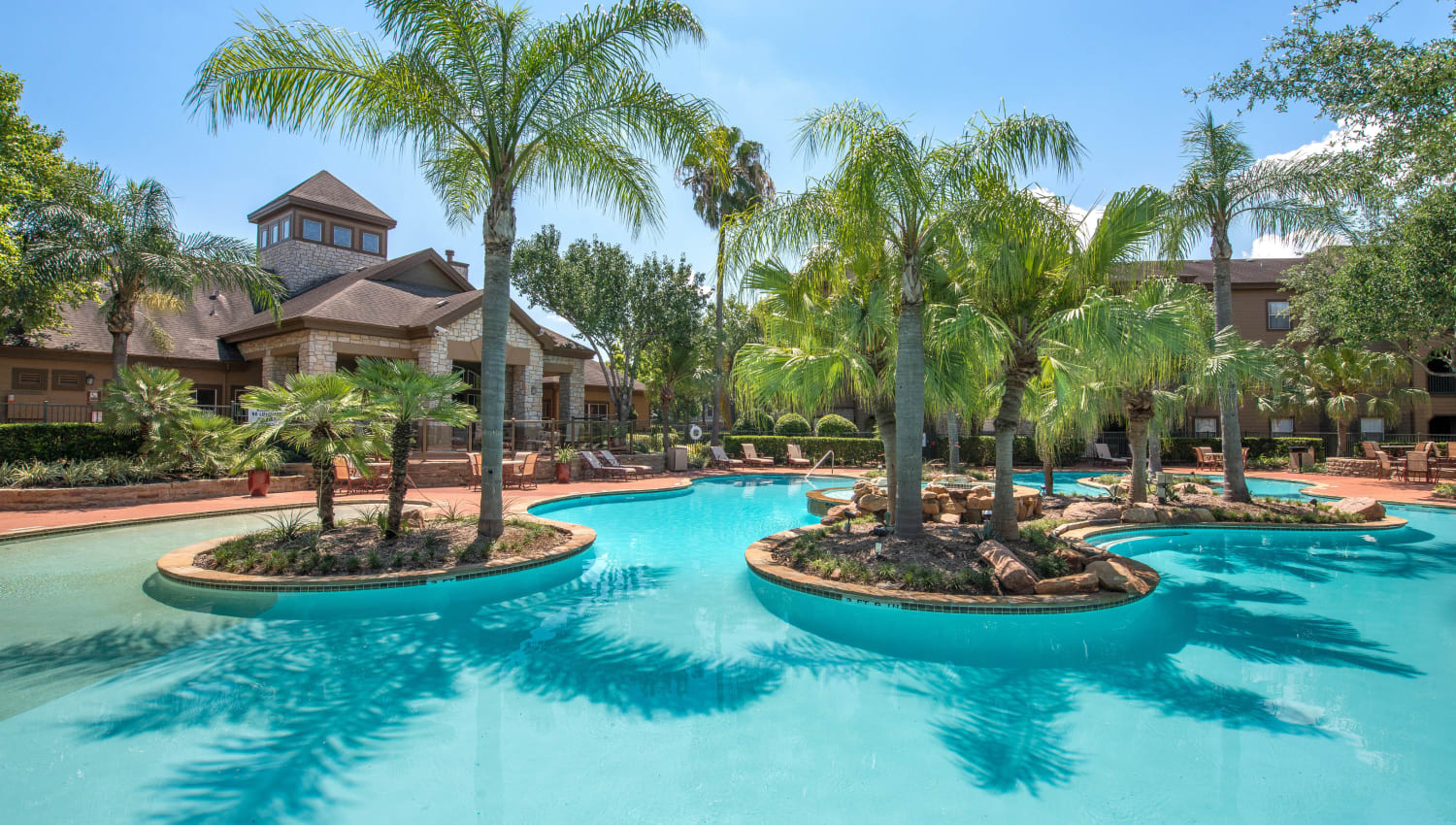 Islands with palm trees in the pool at The Ranch at Shadow Lake in Houston, Texas