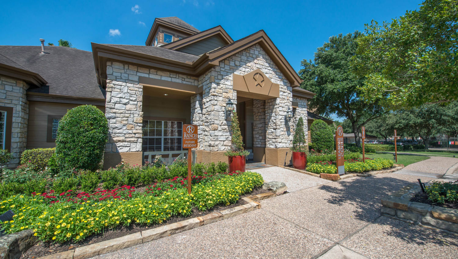 Professionally maintained landscaping outside the leasing center at The Ranch at Shadow Lake in Houston, Texas