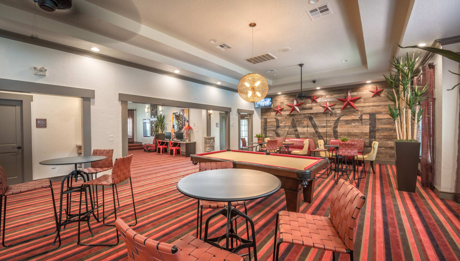 Expansive game room with billiards and more in the clubhouse at The Ranch at Shadow Lake in Houston, Texas
