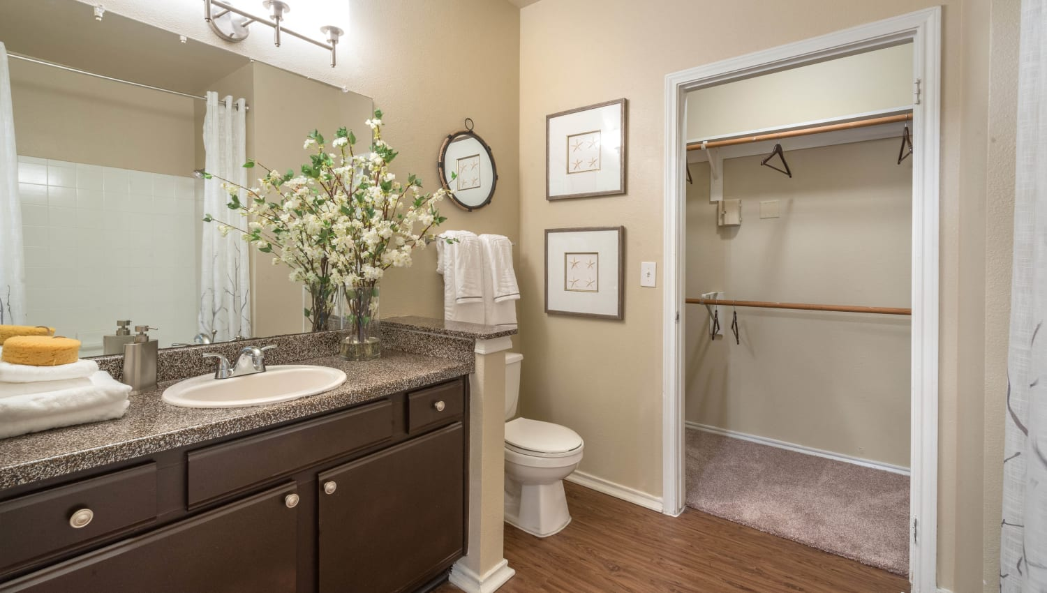 Ample storage in a model apartment's bathroom at The Ranch at Shadow Lake in Houston, Texas