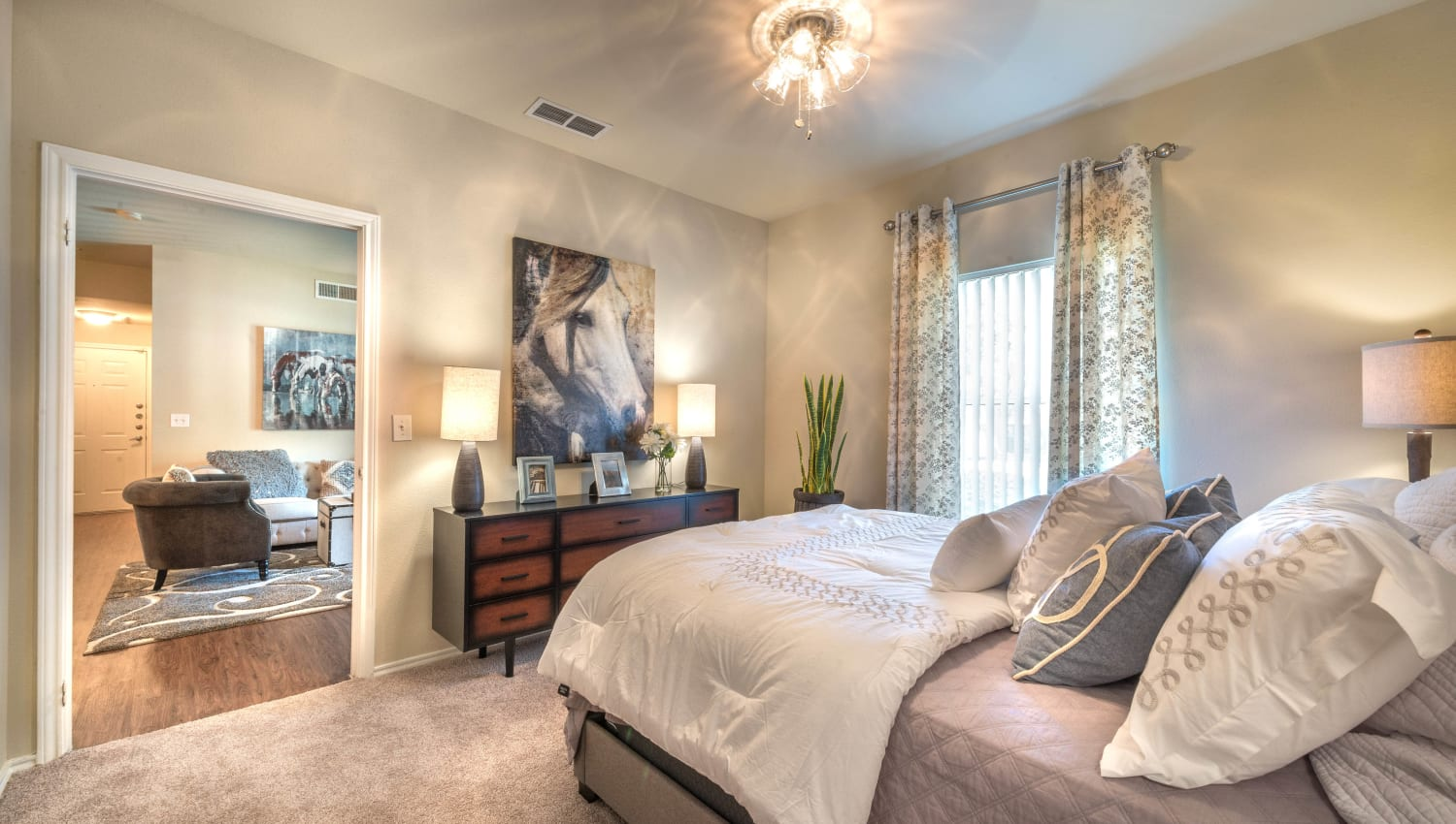 Ceiling fan and plush carpeting in a model home's master bedroom at The Ranch at Shadow Lake in Houston, Texas