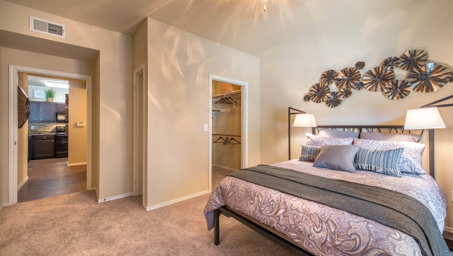 Classically furnished master bedroom in a model apartment at The Ranch at Shadow Lake in Houston, Texas