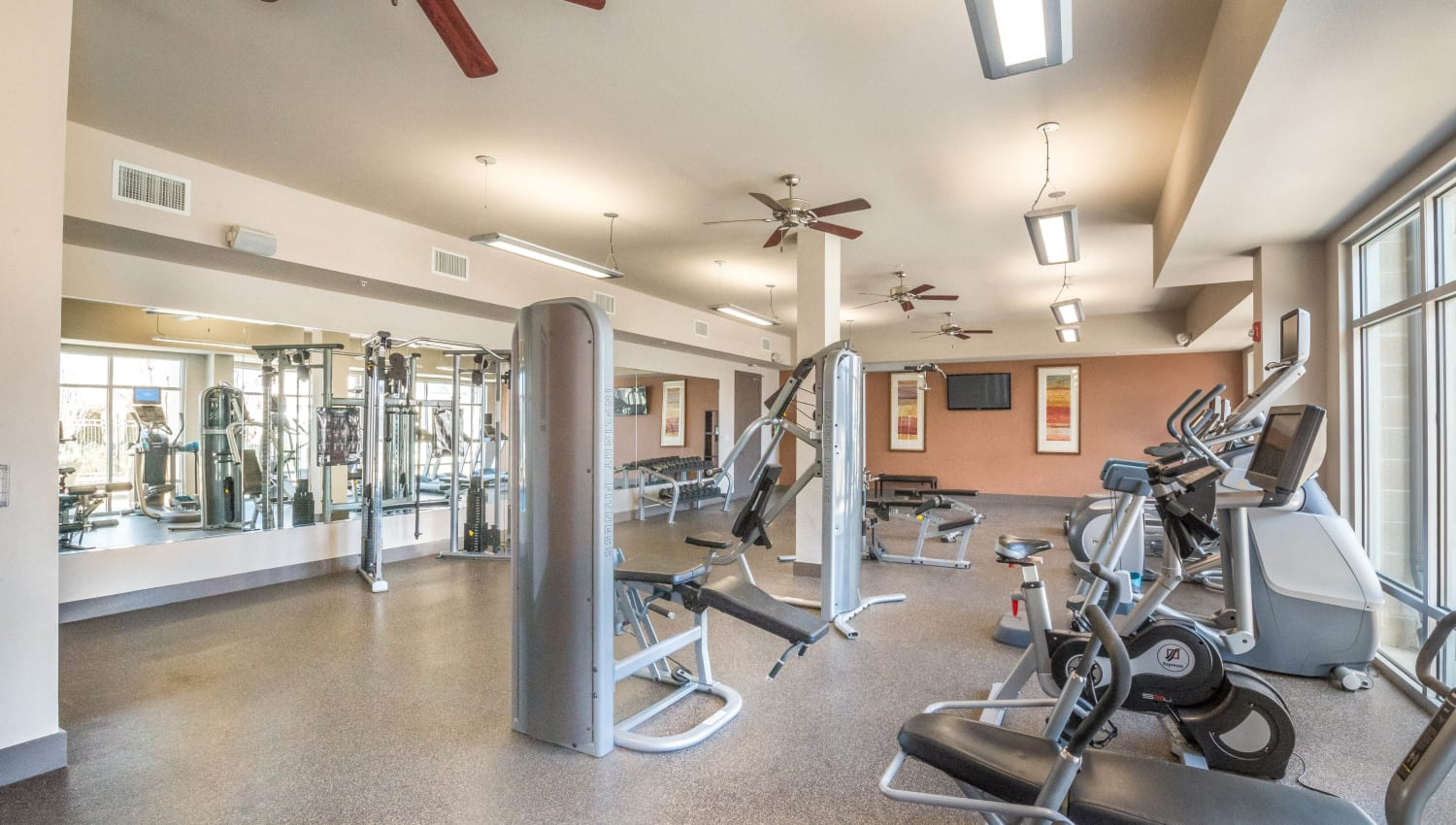 Exercise machines in the fitness center at Union At Carrollton Square in Carrollton, Texas