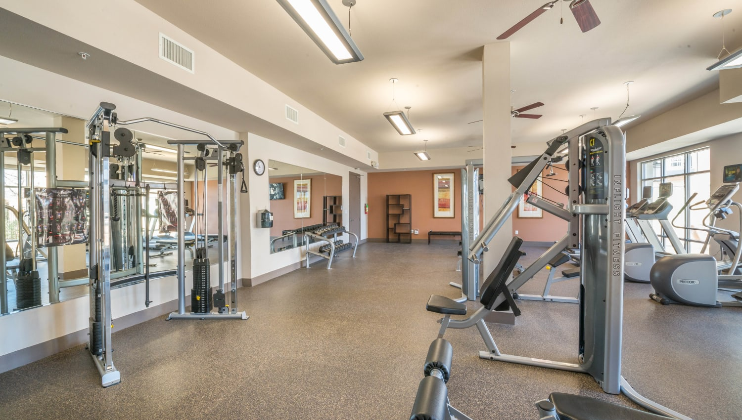 Well-equipped onsite fitness center at Union At Carrollton Square in Carrollton, Texas