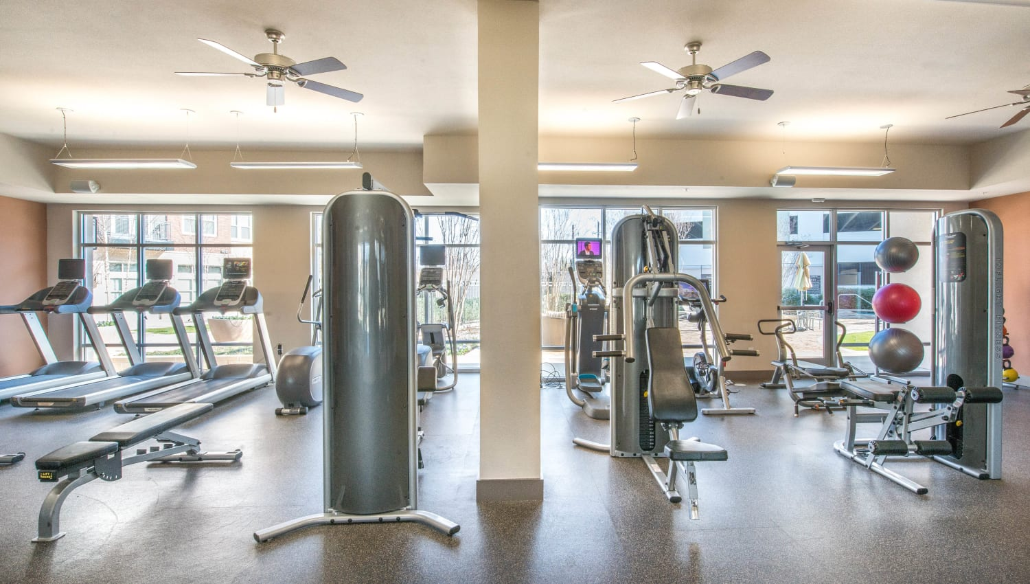 Heavy bag and exercise balls in the fitness center at Union At Carrollton Square in Carrollton, Texas
