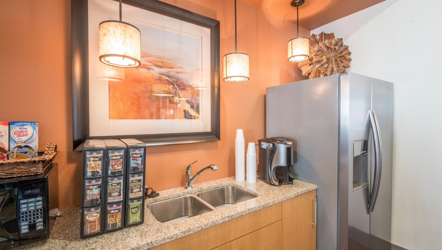 Complimentary coffee station in the lobby at Union At Carrollton Square in Carrollton, Texas