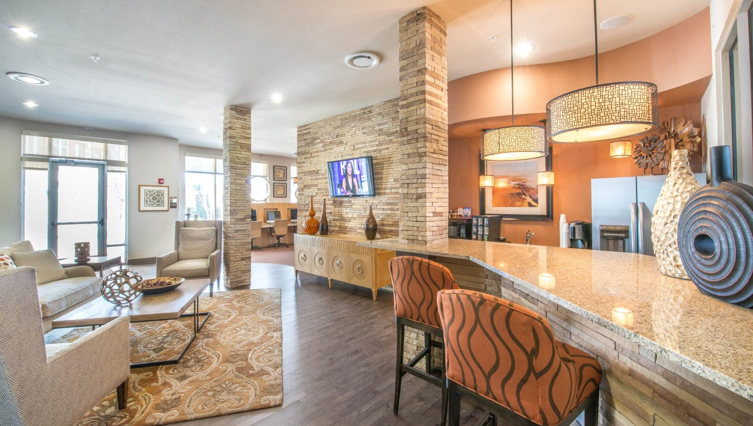 Bar seating at the demonstration kitchen in the clubhouse at Union At Carrollton Square in Carrollton, Texas